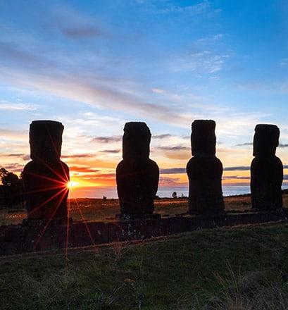 Admire the Ahu Akivi moai facing the ocean
