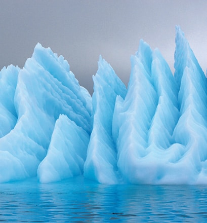 Admire the majestic icebergs